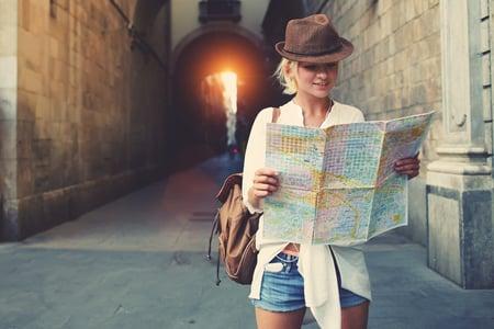 Traveler Reviewing Map