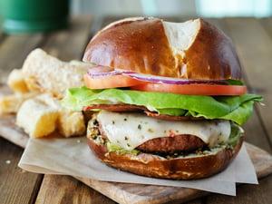 Vegan cheeseburger on pretzel bun