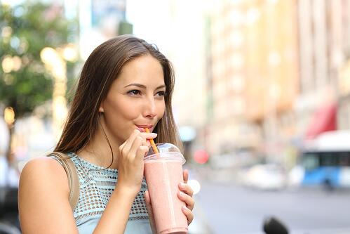 Young Woman Enjoying a Smoothie